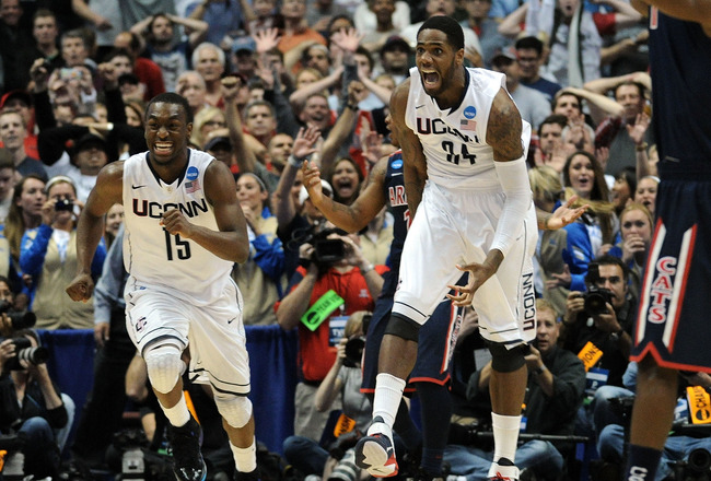 ANAHEIM, CA - MARCH 26:  Kemba Walker #15,  and Alex Oriakhi #34 of the Connecticut Huskies celebrate after defeating the Arizona Wildcats during the west regional final of the 2011 NCAA men's basketball tournament at the Honda Center on March 26, 2011 in