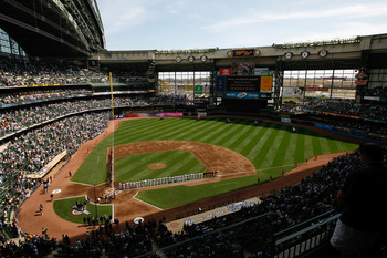 MILWAUKEE, WI - APRIL 05: The Colorado Rockies and Milwaukee Brewers line up on the base lines after introductions during the National Anthem prior to the game between the Colorado Rockies against the Milwaukee Brewers at the Miller Park on April 05, 2010