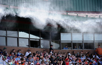 SCOTTSDALE, AZ - MARCH 18:  Mist is sprayed from the roof of the Scottsdale Stadium to keep fans cool during the spring training baseball game of the San Francisco Giants and Los Angeles Dodgers on March 18, 2011 in Scottsdale, Arizona. The temperature du