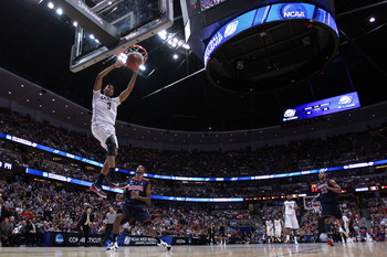 ANAHEIM, CA - MARCH 26:  Jeremy Lamb #3 of the Connecticut Huskies dunks the ball against Kyle Fogg #21 of the Arizona Wildcats during the west regional final of the 2011 NCAA men's basketball tournament at the Honda Center on March 26, 2011 in Anaheim, C