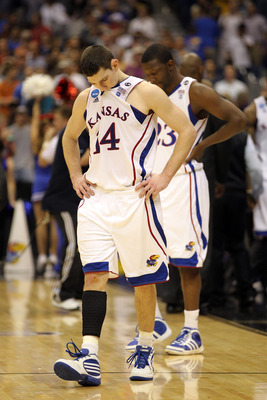 SAN ANTONIO, TX - MARCH 27:  Tyrel Reed #14 and Mario Little #23 of the Kansas Jayhawks react after the southwest regional final of the 2011 NCAA men's basketball tournament against the Virginia Commonwealth Rams at the Alamodome on March 27, 2011 in San