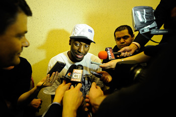 ANAHEIM, CA - MARCH 26:  Kemba Walker #15 of the Connecticut Huskies talks to the media in the locker room after defeating the Arizona Wildcats during the west regional final of the 2011 NCAA men's basketball tournament at the Honda Center on March 26, 20