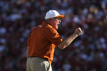 DALLAS - OCTOBER 02:  Head coach Mack Brown of the Texas Longhorns yells on the sidelines during play against the Oklahoma Sooners at the Cotton Bowl on October 2, 2010 in Dallas, Texas.  (Photo by Ronald Martinez/Getty Images)