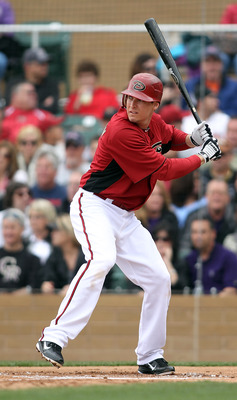 SCOTTSDALE, AZ - FEBRUARY 26:  Kelly Johnson #2 of the Arizona Diamondbacks swings his bat against the Colorado Rockies at Salt River Fields on February 26, 2011 in Scottsdale, Arizona..  (Photo by Jonathan Ferrey/Getty Images)