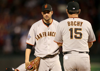 ARLINGTON, TX - OCTOBER 30:  Starting pitcher Jonathan Sanchez #57 of the San Francisco Giants hands the ball to manager Bruce Bochy after he was taken out of the game in the bottom of the fifth inning against the Texas Rangers in Game Three of the 2010 M