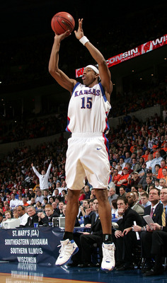 OKLAHOMA CITY - MARCH 18:  J.R. Giddens #15 of the Kansas Jayhawks shoots a three-pointer in the second half against the Bucknell Bison in the first round of the NCAA Men's Basketball Championship on March 18, 2005 at the Ford Center in Oklahoma City, Okl