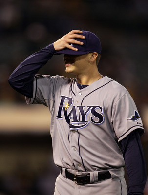 OAKLAND, CA - AUGUST 20:  Jeremy Hellickson #58 of the Tampa Bay Rays walks off the field after the sixth inning in which he gave up a home run to tie their game against the Oakland Athletics at the Oakland-Alameda County Coliseum  on August 20, 2010 in O