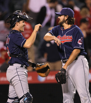 ANAHEIM, CA - SEPTEMBER 06:  Closer Chris Perez #54 and catcher Lou Marson #14 of the Cleveland Indians celebrate after getting the final out against the Los Angeles Angels of Anaheim on September 6, 2010 at Angel Stadium in Anaheim, California. The India