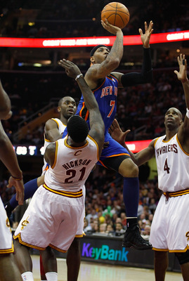 CLEVELAND - FEBRUARY 25:  Carmelo Anthony #7 of the New York Knicks drives to the net in front of J.J. Hickson #21 of the Cleveland Cavaliers on his way to the basket during the game on February 25, 2011 at Quicken Loans Arena in Cleveland, Ohio. NOTE TO