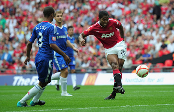 LONDON, ENGLAND - AUGUST 08:  Antonio Valencia of Manchester United (C) beats Henrique Hilario of Chelsea to score their first goal during the FA Community Shield match between Chelsea and Manchester United at Wembley Stadium on August 8, 2010 in London,