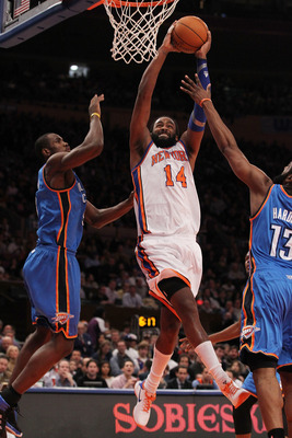NEW YORK, NY - DECEMBER 22:  Ronny Turiaf #14 of the New York Knicks scores against the Oklahoma City Thunder at Madison Square Garden on December 22, 2010 in New York City.   NOTE TO USER: User expressly acknowledges and agrees that, by downloading and/o