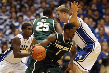 DURHAM, NC - DECEMBER 01:  Kalin Lucas #1 of the Michigan State Spartans tries to dribble out of a trap by Kyrie Irving #1 and Mason Plumlee #5 of the Duke Blue Devils during their game at Cameron Indoor Stadium on December 1, 2010 in Durham, North Caroli