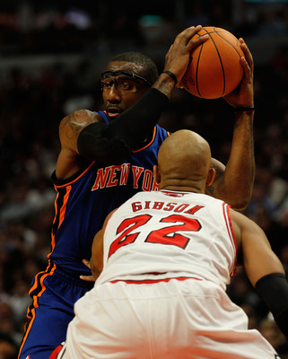 CHICAGO - NOVEMBER 04: Amar'e Stoudemire #1 of the New York Knicks looks to pass under pressure from Taj Gibson #22 of the Chicago Bulls at the United Center on November 4, 2010 in Chicago, Illinois. The Knicks defeated the Bulls 120-112. NOTE TO USER: Us