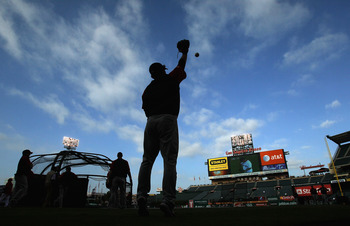 ANAHEIM, CA - SEPTEMBER 07:  A silhouette of Shin-Soo Choo #17 of the Cleveland Indians warming up prior to the start of the game against the Los Angeles Angels of Anaheim at Angel Stadium on September 7, 2010 in Anaheim, California.  (Photo by Jeff Gross