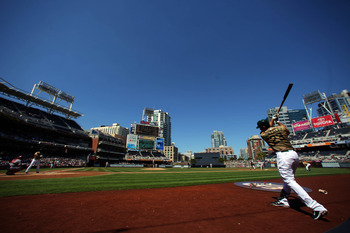 SAN DIEGO, CA - SEPTEMBER 26:  Adrian Gonzalez #23 of the San Diego Padres prepares himself in the on deck circle against  the Cincinnati Reds during their MLB game on September 26, 2010 at PETCO Park in San Diego, California. (Photo by Donald Miralle/Get