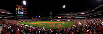 PHILADELPHIA - OCTOBER 23:  (***EDITORS NOTE*** THIS PANORAMIC COMPOSITE IMAGE WAS CREATED USING PHOTO STITCHING SOFTWARE) Roy Oswalt #44 of the Philadelphia Phillies pitches against Buster Posey #28 of the San Francisco Giants in Game Six of the NLCS dur