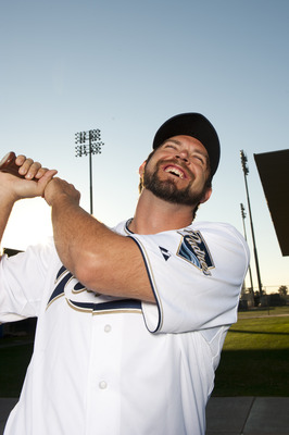 PEORIA, AZ - FEBRUARY 23: Heath Bell #21 of the San Diego Padres poses during their photo day at the Padres Spring Training Complex on February 23, 2011 in Peoria, Arizona. (Photo by Rob Tringali/Getty Images)