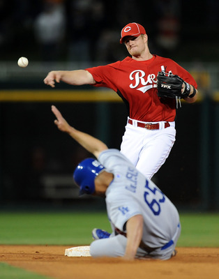 GOODYEAR, AZ - MARCH 03: Zack Cozart #60 of the Cincinnati Reds turns a double play as Ivan De Jesus #65 of the Los Angeles Dodgers slides into second base at Goodyear Ballpark on March 3, 2011 in Goodyear, Arizona.  (Photo by Norm Hall/Getty Images)