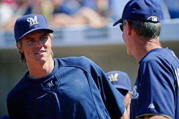 PHOENIX, AZ - MARCH 10:  Pitcher Zack Greinke #13  of the Milwaukee Brewers  speaks with manager Ron Roenicke during the spring training baseball game against Colorado Rockies at Maryvale Baseball Park on March 10, 2011 in Phoenix, Arizona.  (Photo by Kev