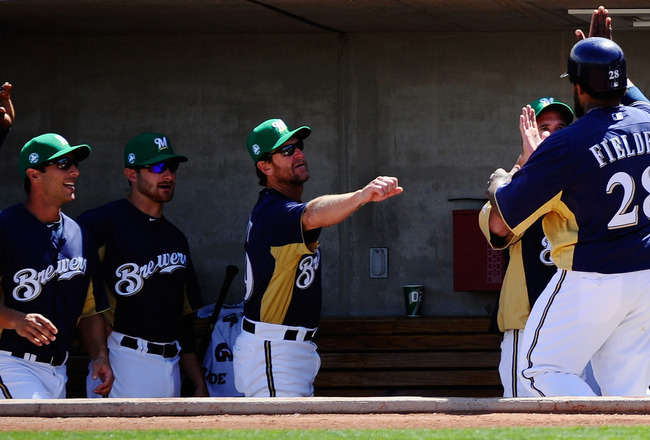 PHOENIX, AZ - MARCH 17:  Prince Fielder #28 of the Milwaukee Brewers is congratulated by teammates after scoring on a two-run double by Jeremy Reed #62 against pitcher Edwin Jackson #33 of the Chicago White Sox during the first inning of the spring traini