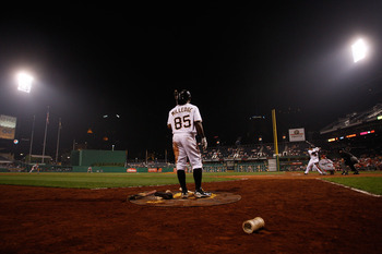 PITTSBURGH - AUGUST 03:  Lastings Milledge #85 of the Pittsburgh Pirates waits in the on deck circle while Pedro Alvarez #17 bats against the Cincinnati Reds during the game on August 3, 2010 at PNC Park in Pittsburgh, Pennsylvania.  (Photo by Jared Wicke