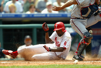 PHILADELPHIA  - MAY 29:  Doug Glanville #6 of the Philadelphia Phillies slides into home as catcher Johnny Estrada #23 of the Atlanta Braves attempts to guard the plate on May 29, 2004 at Citizens Bank Park in Philadelphia, Pennsylvania.  (Photo by Jamie