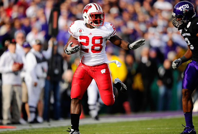 PASADENA, CA - JANUARY 01:  Running back Montee Ball #28 of the Wisconsin Badgers rushes with the ball against the TCU Horned Frogs in the first quarter of the 97th Rose Bowl game on January 1, 2011 in Pasadena, California.  (Photo by Kevork Djansezian/Ge