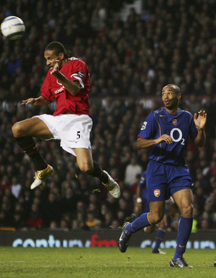 MANCHESTER, ENGLAND - OCTOBER 24: Rio Ferdinand (L) Thierry Henry (C) and Gary Neville (R) during the FA Barclays Premiership match between Manchester United and Arsenal at Old Trafford on October 24, 2004 in Manchester, England.  (Photo by Laurence Griff