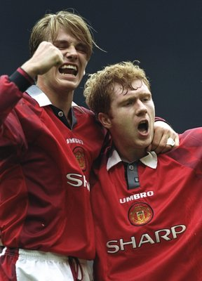 28 Mar 1998:  David Beckham and Paul Scholes of Manchester United celebrate during the FA Carling Premiership match against Wimbledon at Old Trafford in Manchester, England. United won 2-0. \ Mandatory Credit: Mark Thompson /Allsport