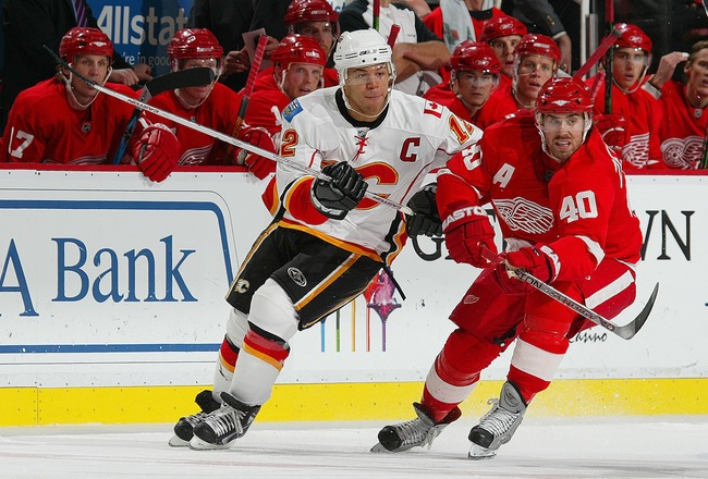 DETROIT - OCTOBER 10:  Jarome Iginla #12 of the Calgary Flames tries to check Henrik Zetterberg #40 of the Detroit Red Wings in a game on October 10, 2007 at the Joe Louis Arena in Detroit, Michigan. The Red Wings defeated the Flames 4-2. (Photo by Claus