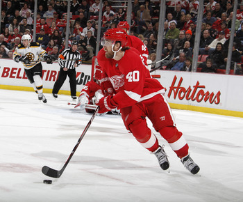 DETROIT, MI - FEBRUARY 13:  Henrik Zeterberg #40 of the Detroit Red Wings skates with the puck against the Boston Bruins on February 13, 2011 in Detroit, Michigan.  (Photo by Gregory Shamus/Getty Images)