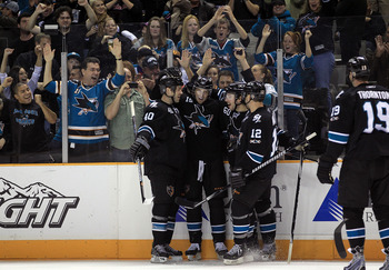 SAN JOSE, CA - NOVEMBER 15:  Dany Heatley #15 of the San Jose Sharks is congratulated by teammates Kent Huskins #40, Jason Demers #60, Patrick Marleau #12 and Joe Thornton #19 after he scored a goal during their game against the Los Angeles Kings at HP Pa