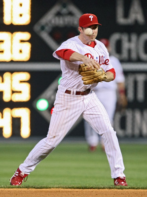 PHILADELPHIA - MAY 27: Chase Utley #26 of the Philadelphia Phillies throws the ball to first base during the game against the Colorado Rockies at Citizens Bank Park May 27, 2008 in Philadelphia, Pennsylvania. (Photo by Drew Hallowell/Getty Images)