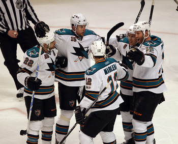 CHICAGO, IL - MARCH 14: (L-R) Dan Boyle #22, Dany Heatley #15, Patrick Marleau #12, Ian White #9 and Joe Thornton #19 of the San Jose Sharks celebrate a goal against the Chicago Blackhawks at the United Center on March 14, 2011 in Chicago, Illinois. The B