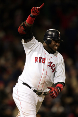 David Ortiz celebrates as he rounds the bases after his walk-off home run to win Game 4 of the 2004 ALCS.