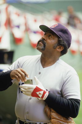 1986:  Former Boston Red Sox player Luis Tiant '71-'78,  signs autograghs before a game during the 1986 season. (Photo by: Stephen Dunn/Getty Images)