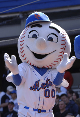 Mr. Met applauds as the  Milwaukee Brewers play  against the New York Mets  April 16, 2006 in New York. (Photo by Al Messerschmidt/WireImage)