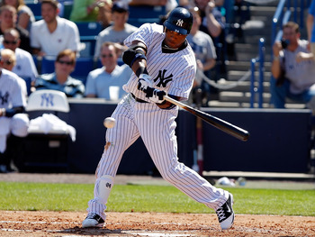 TAMPA, FL - FEBRUARY 26:  Infielder Robinson Cano #24 of the New York Yankees fouls off a pitch against the Philadelphia Phillies during a Grapefruit League Spring Training Game at George M. Steinbrenner Field on February 26, 2011 in Tampa, Florida.  (Pho