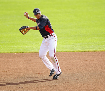 LAKE BUENA VISTA, FL - FEBRUARY 21:  Martin Prado #14 of the Atlanta Braves fields ground balls during a spring training workout at Champion Stadium on February 21, 2011 in Lake Buena Vista, Florida.  (Photo by Mike Ehrmann/Getty Images)