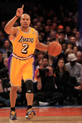 NEW YORK, NY - FEBRUARY 11: Derek Fisher #2 of the Los Angeles Lakers dribbles the ball against the New York Knicks at Madison Square Garden on February 11, 2011 in New York City. NOTE TO USER: User expressly acknowledges and agrees that, by downloading a