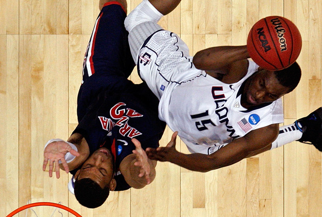 ANAHEIM, CA - MARCH 26:  Kemba Walker #15 of the Connecticut Huskies goes to the basket against Jamelle Horne #42 of the Arizona Wildcats during the west regional final of the 2011 NCAA men's basketball tournament at the Honda Center on March 26, 2011 in