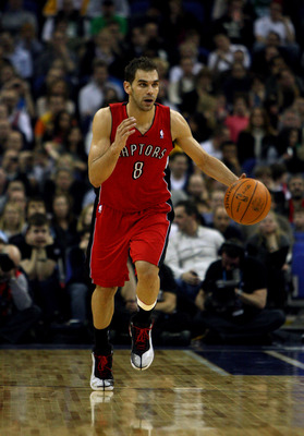 LONDON, ENGLAND - MARCH 04:  #8 Jose Calderon of the Raptors in action during the NBA match between New Jersey Nets and the Toronto Raptors at the O2 Arena on March 4, 2011 in London, England. NOTE TO USER: User expressly acknowledges and agrees that, by