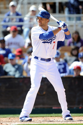 PHOENIX, AZ - FEBRUARY 27:  James Loney #7 of the Los Angeles Dodgers at bat during spring training at Camelback Ranch on February 27, 2011 in Phoenix, Arizona.  (Photo by Harry How/Getty Images)