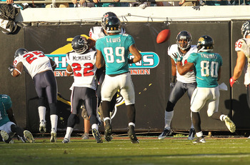 JACKSONVILLE, FL - NOVEMBER 14:  Mike Thomas #80 of the Jacksonville Jaguars catches a tipped pass winning a game against the Houston Texans at EverBank Field on November 14, 2010 in Jacksonville, Florida.  (Photo by Mike Ehrmann/Getty Images)