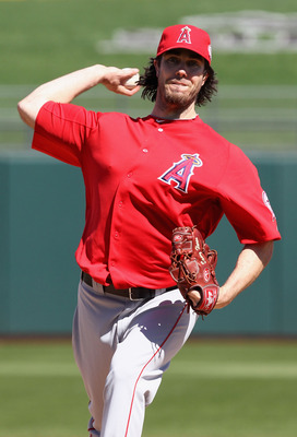 SURPRISE, AZ - MARCH 02:  Starting pitcher Dan Haren #24 of the Los Angeles Angels of Anaheim pitches against the Texas Rangers during the spring training game at Surprise Stadium on March 2, 2011 in Surprise, Arizona.  (Photo by Christian Petersen/Getty