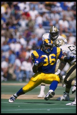 10 Sep 1995: Running back Jerome Bettis (center) of the St. Louis Rams runs against the New Orleans Saints during a game played at Busch Stadium in St. Louis, Missouri, The Rams won the game, 17-13.