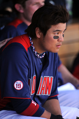 GOODYEAR, AZ - MARCH 11:  Shin-Soo Choo #17 of the Cleveland Indians sits in the dugout between innings against the Seattle Mariners at Goodyear Ballpark on March 11, 2011 in Goodyear, Arizona.  (Photo by Norm Hall/Getty Images)