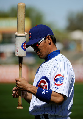 MESA, AZ - MARCH 09:  Kosuke Fukudome #1 of the Chicago Cubs warms up prior to the start of the spring training baseball game against the Kansas City Royals at HoHoKam Stadium on March 9, 2011 in Mesa, Arizona.  (Photo by Kevork Djansezian/Getty Images)