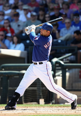 SURPRISE, AZ - MARCH 11:  Mitch Moreland #18 of the Texas Rangers hits a RBI double against the Cincinnati Reds during the second inning of the spring training game at Surprise Stadium on March 11, 2011 in Surprise, Arizona.  (Photo by Christian Petersen/