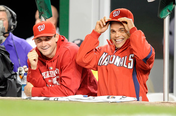 WASHINGTON - SEPTEMBER 29:  Ryan Zimmerman #11 and Ivan Rodriguez #7 of the Washington Nationals watch the game against the Philadelphia Phillies at Nationals Park on September 29, 2010 in Washington, DC.  (Photo by Greg Fiume/Getty Images)